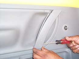 removing handle trim from door panel